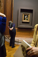 NEW YORK - NOV 1: Members of The Frick Collection attend a members only viewing of Vermeer's Girl With The Pearl Earring painting at The Frick Collection on Friday, November 1, 2013, in New York City. (Photo by Landon Nordeman)