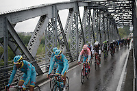 Team Astana leading the way (and their teammate Vincenzo Nibali in the Maglia Rosa) to Torino passing a bridge<br /> <br /> stage 21: Cuneo - Torino 163km<br /> 99th Giro d'Italia 2016