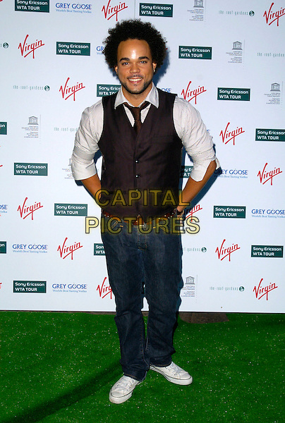 NATE JAMES.At a Sony Ericsson WTA Tour Pre-Wimbledon Party, The Roof Gardens, Kensington, London, England,.June 21st, 2007. full length waistcoat tie jeans converse trainers.CAP/CAN.©Can Nguyen/Capital Pictures