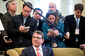 United States Secretary of Defense Ashton Carter listens as U.S. President Barack Obama, not pictured, speaks during a meeting in the Oval Office of the White House in Washington, D.C., U.S., on Tuesday, Feb. 17, 2015. Carter, sworn in as defense secretary today, inherits an array of defense and foreign policy challenges that are likely to help define the remaining two years of Obama's presidency.<br /> Credit: Andrew Harrer / Pool via CNP