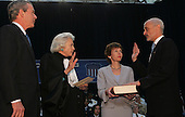 Washington, D.C. - March 3, 2005 -- Michael Chertoff is sworn-in as Secretary of Homeland Security by Associate Justice of the United States Supreme Court Sandra Day O'Connor at the Ronald Reagan Building in Washington, D.C. on March 3, 2005. From left to right: United States President George W. Bush; Justice O'Connor, Mrs. Meryl Chertoff, Michael Chertoff.<br /> Credit: Dennis Brack - Pool via CNP