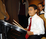 Klaudio Grilo, 9, plays drums at the Houston Symphony League's annual Magical Musical Morning event at the Houstonian Saturday Dec. 12,2009.(Dave Rossman/For the Chronicle)