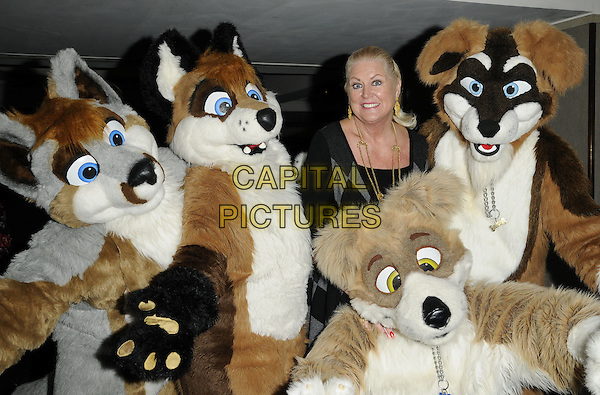 KIM WOODBURN .Attending 'Mad Hatters Tea Party' event organised by London Taxi Drivers Fund for Underprivileged Children at the Grosvenor House Hotel, Park Lane, London, England, UK..January 31st 2010..half length grey gray diamond knitted knit pattern jumper sweater animals dressed-up dog fox costumes .CAP/CAN.©Can Nguyen/Capital Pictures