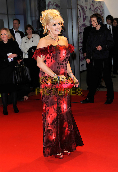 BEVERLEY CALLARD .At the National Television Awards, held at O2 Arena, London, England, UK, January 20th 2010..arrivals TV NTA full length strapless off the shoulders red long maxi dress clutch bag print pattern feathers feather trim .CAP/FIN.©Steve Finn/Capital Pictures.