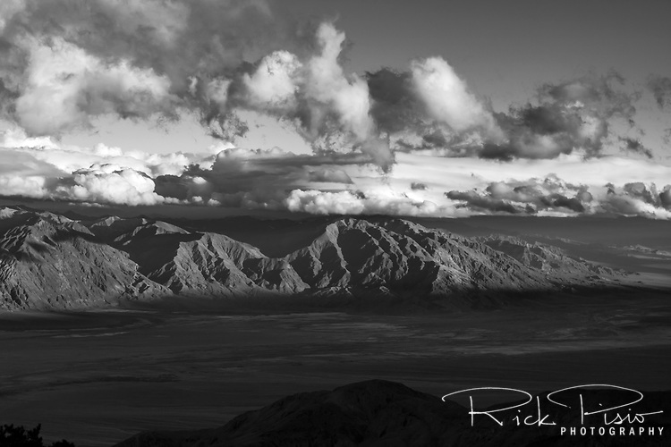 The last of the day's light touches the peaks of the Amargosa Range in Death Valley National Park above Badwater.