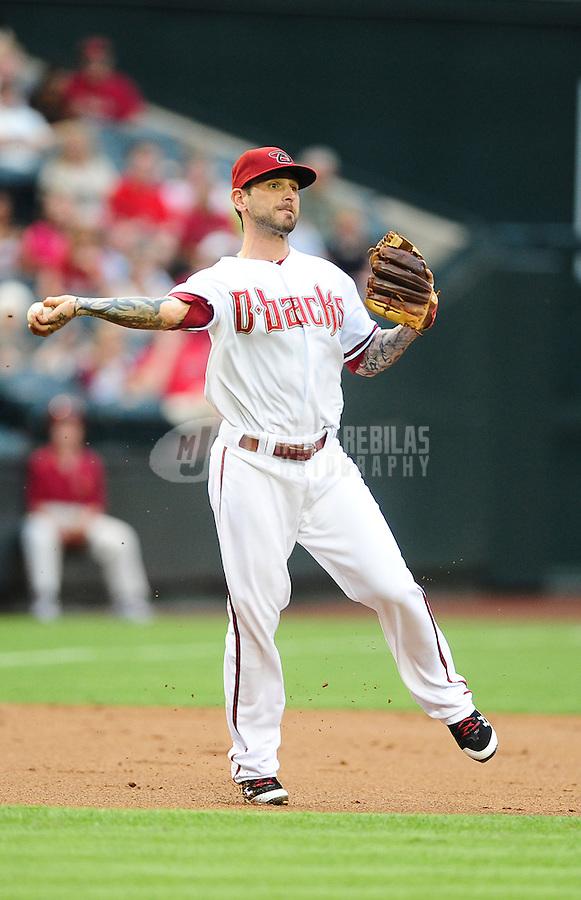 May 31, 2011; Phoenix, AZ, USA; Arizona Diamondbacks third baseman Ryan Roberts throws to first base for an out in the first inning against the Florida Marlins at Chase Field. Mandatory Credit: Mark J. Rebilas-