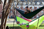 Ohio University has both a Ukelele Club and a Hammock Club. Chirs Markijohn plays ukelele above Sarah Holm outside of Morton Hall on February 24, 2017.
