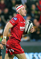 Gareth Davies of the Scarlets grabs the ball after scoring a try during the Guinness PRO14 Round 6 match between Ospreys and Scarlets at The Liberty Stadium , Swansea, Wales, UK. Saturday 07 October 2017
