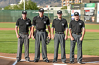 The umpiring crew of Trevor Danneger, Jake Botek, Conner Culhane and Forrest Ladd pose for a photo prior to the start of the 2nd Annual Northwest League-Pioneer League All-Star Game at Lindquist Field on August 2, 2016 in Ogden, Utah. The Northwest League defeated the Pioneer League 11-5. (Stephen Smith/Four Seam Images)