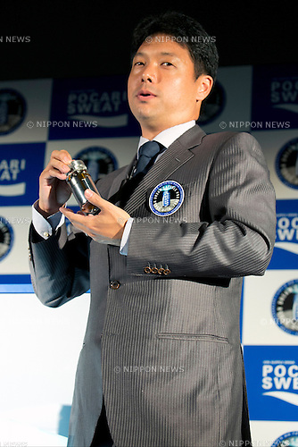 "Tokyo, Japan - Tokyo, Japan - Mitsunobu Okada, CEO of Astroscale Pte. Ltd. shows the inside of the Pocari Sweat capsule during the ""Lunar Dream Capsule Project"" press conference at the Konica Minolta planetarium ""Tenku"" in Tokyo Sky Tree on May 15, 2014. The ""Lunar Dream Executive Committee"" is run by Astrobotic Technology Inc. (USA), ASTROSCALE (Singapore) and Otsuka Pharmaceutical, will launch a space mission led solely by private companies to send Pocari Sweat capsule with the dream of many kids around the world to land on the moon on November 2015 (Photo by Rodrigo Reyes Marin/AFLO)"