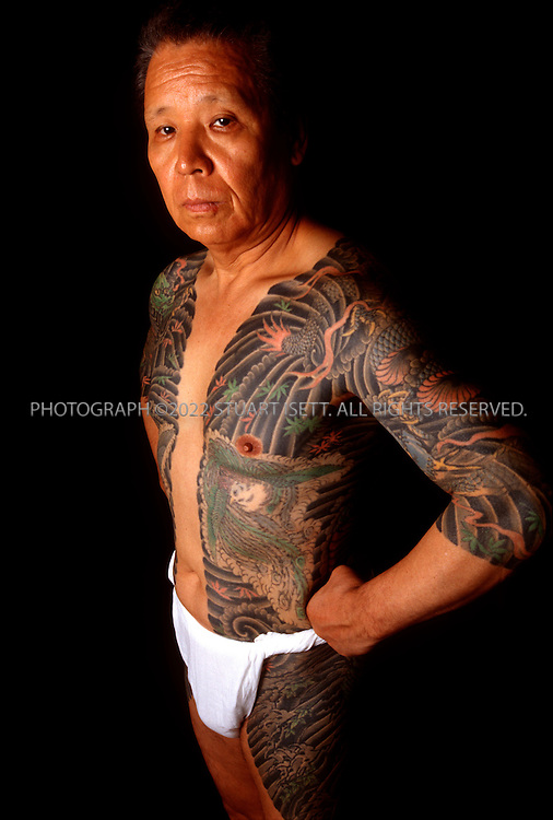 8/15/03--Tokyo, Japan..A Japanese yakuza with tatoos. Inside the offices of a Tokyo-based Yakuza crime gang in the city's famous Kabukicho red light district...Photograph by Stuart Isett.©2004 Stuart Isett
