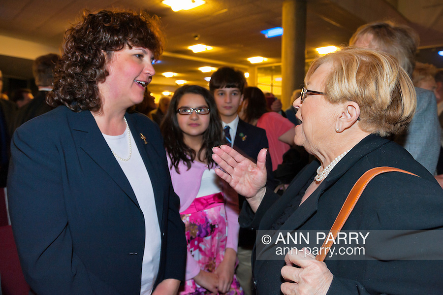 Nassau County Executive Edward Mangano gives State of the County Address, on Wednesday night, March 14, 2012, at Cradle of Aviation museum, Garden City, New York, USA. At right, Legislator Judy Jacobs speaks with family of John Capano, the ATF agent Alcohol Tobacco & Firearms) fatally shot months earlier while trying to stop a pharmacy robbery. (NOTE: Sharp focus is on Legislator Jacobs)