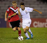 Marc Pelosi (11) of the United States tries to get past Bryce Alderson (8) of Canada during the finals of the CONCACAF Men's Under 17 Championship at Catherine Hall Stadium in Montego Bay, Jamaica. The United States defeated Canada, 3-0, in overtime