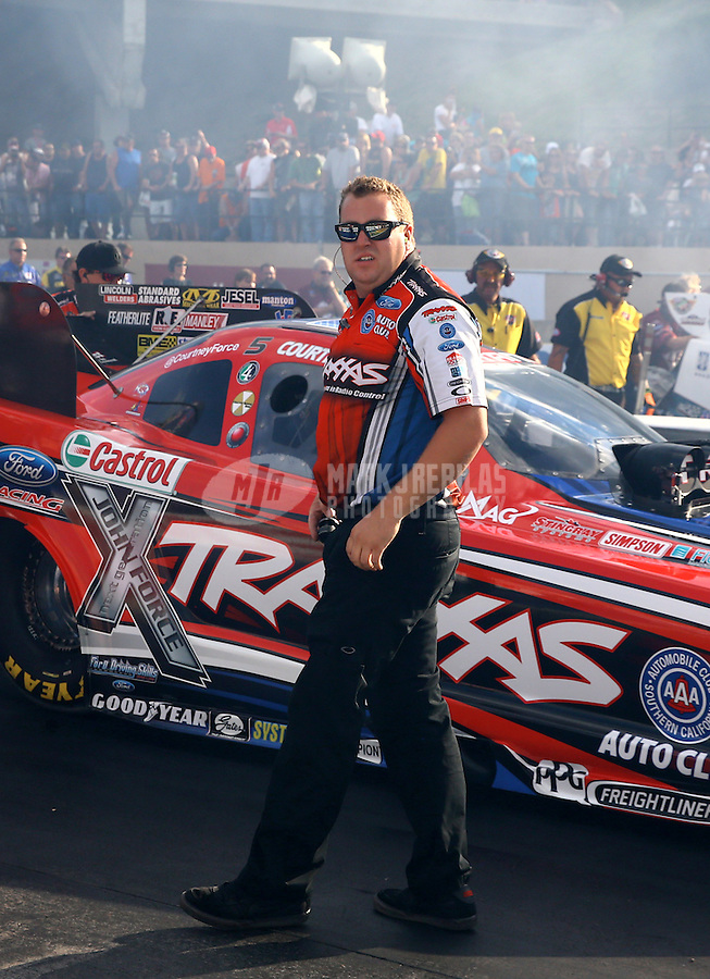 Jul. 19, 2013; Morrison, CO, USA: NHRA crew member for funny car driver Courtney Force during qualifying for the Mile High Nationals at Bandimere Speedway. Mandatory Credit: Mark J. Rebilas-