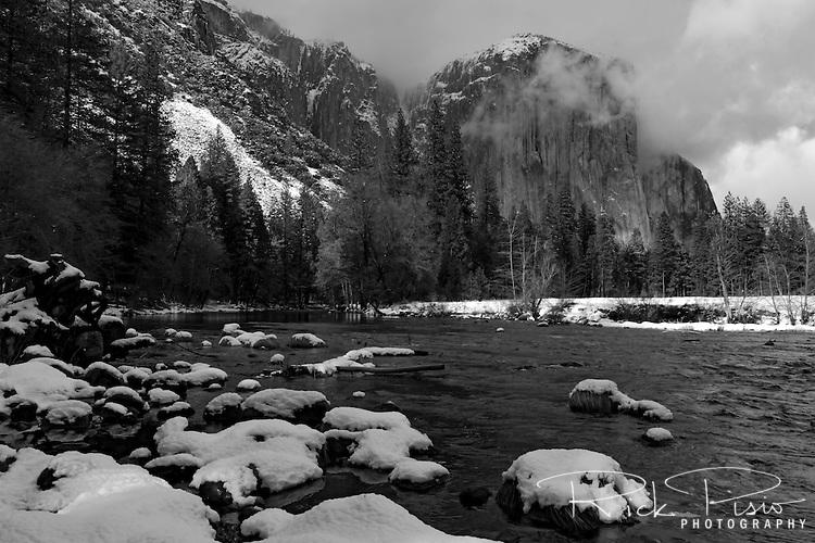 Snow lines the Merced River below  El Capitan in Yosemite National Park.