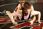 02/26/11--West Linn's Ryan Harman avoids being pinned by Roseburg's Dylan Fors in the 171 weight division of the 6A wrestling state championship at the Memorial Coliseum..Photo by Jaime Valdez..........................................