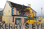 CHANGING TIMES: James Condon, son of the founder of M Condon and Sons shop in Kilflynn watched on as diggers tore it to the ground on Monday morning.