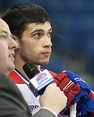Joseph Pendenza (UML - 14) waits to be interviewed. - The University of Massachusetts Lowell River Hawks defeated the visiting American International College Yellow Jackets 6-1 on Tuesday, December 3, 2013, at Tsongas Arena in Lowell, Massachusetts.