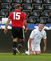 Mark Gower of Swansea Legends (R) smiles to Clayton Blackmore of Manchester United Legends during the Alan Tate Testimonial Match, Swansea City Legends v Manchester United Legends at the Liberty Stadium, Swansea, Wales, UK