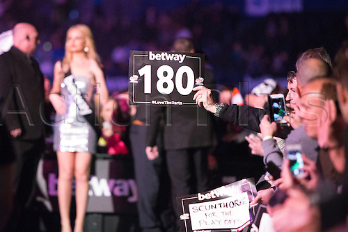 28.04.2016. Barclaycard Arena, Birmingham, England. Betway PDC Premier League Darts. Night 13. Fans wave signs.