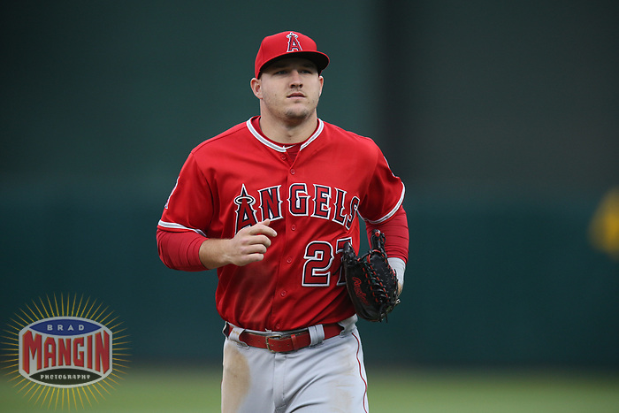 OAKLAND, CA - JUNE 15:  Mike Trout #27 of the Los Angeles Angels of Anaheim runs off the field against the Oakland Athletics during the game at the Oakland Coliseum on Friday, June 15, 2018 in Oakland, California. (Photo by Brad Mangin)