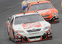 14 September 2008--Joey Logano leads temmate Tony Stewart during the Sylvania 300 at New Hampshire Motor Speedway in Loudon, NH.  (Brian Cleary/BCPix.com)