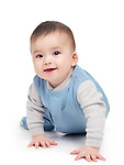Portrait of a smiling happy seven month old baby boy crawling isolated on white background.