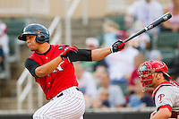 Miguel Gonzalez #32 of the Kannapolis Intimidators follows through on his swing against the Lakewood BlueClaws at Fieldcrest Cannon Stadium on July 16, 2011 in Kannapolis, North Carolina.  The Intimidators defeated the BlueClaws 5-3.   (Brian Westerholt / Four Seam Images)