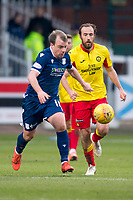 8th February 2020; Dens Park, Dundee, Scotland; Scottish Championship Football, Dundee versus Partick Thistle; Paul McGowan of Dundee races away from Stuart Bannigan of Partick Thistle