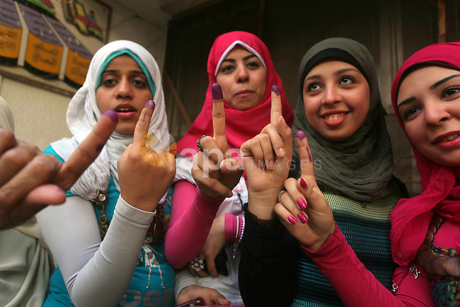 Egyptian women show thier ink-marked finger after casting thier ballot during the first round of Egypt's presidential elections, at a polling station in Cairo, Egypt, 24 May 2012. for the first Presidential election since the ouster of former president Hosni Mubarak in February 2011. The first round vote is on 23 and 24 May. Photo by Ashraf Amra. Photo by Ashraf Amra