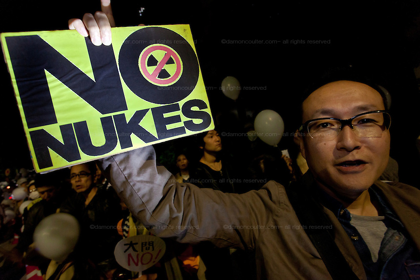 An anti Nuclear protestor holds a No Nukes sign at the Friday night protests around the parliament building in Nagatacho, Tokyo, Japan Friday October 12th 2012