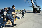 U.S. military personnel load a U.S. Navy Blackhawk helicopter in Port-au-Prince on January 22 with emergency aid for the isolated town of Jacmel on Haiti's southern coast. The aid was provided by Diakonie, part of the ACT Alliance, in a joint operation with Caritas Internationalis.