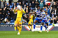 Tyler Blackett of Reading congratulates Modou Barrow of Reading right on scoring the second goal to make the score 2-2  as Joe Garner of Wigan Athletic covers his face  during Reading vs Wigan Athletic, Sky Bet EFL Championship Football at the Madejski Stadium on 9th March 2019