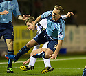 Forfar's Iain Campbell is caught late by Ayr Utd's Anthony Marenghi.