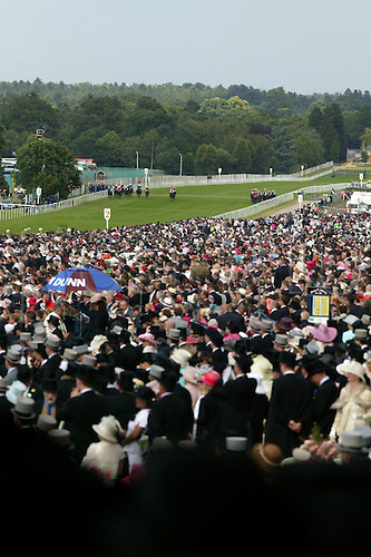 18 June 2004: The field in the Buckingham Palace Stakes are watched by people in the packed stands at Royal Ascot. Photo: Steve Bardens/Action Plus...040618 horse racing crowds racegoers