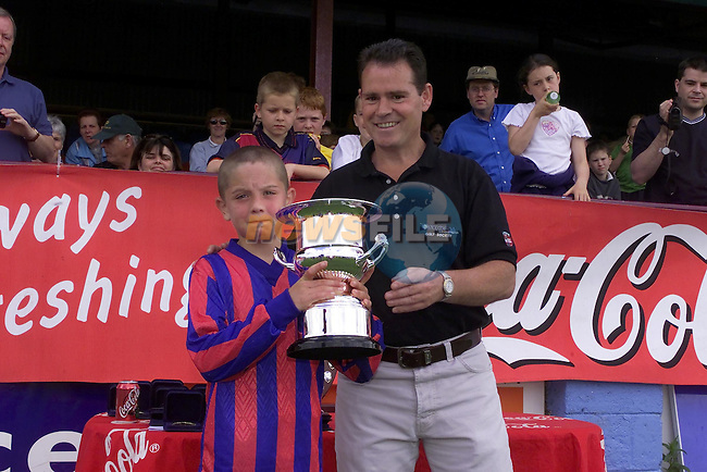 captain of Walshestown U/10 being presented with there trophy from Gerry Farrell from Drogheda Concentrates..Picture Fran Caffrey Newsfile.