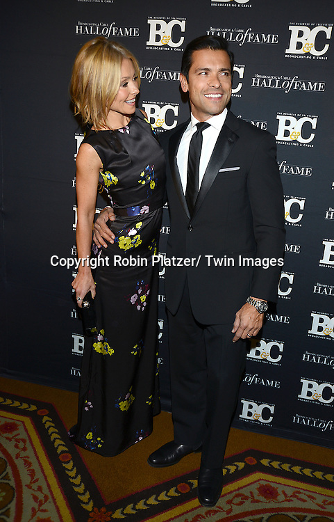 Kelly Ripa and husband Mark Consuelos attend the Broadcasting & Cable Hall of Fame Awards Dinner on October 28, 2013 at the Waldorf-Astoria Hotel in New York City.