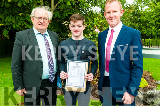 Leaving Cert Results: Darragh McAuliffe, Leim, Kilflynn who received 7 A1's in his leaving Cert at St.Michael's College Listowel pictured with headmaster Johnny Mulvihill & deputy headmaster Liam Hassett on Wednesday morning last.