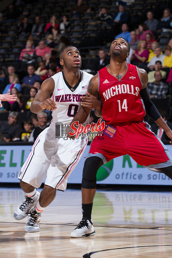 Codi Miller-McIntyre (0) of the Wake Forest Demon Deacons works for position under the basket against Ja'Dante' Frye (14) of the Nicholls Colonels during second half action at the LJVM Coliseum on November 24, 2014 in Winston-Salem, North Carolina.  The Demon Deacons defeated the Colonels 75-48.   (Brian Westerholt/Sports On Film)