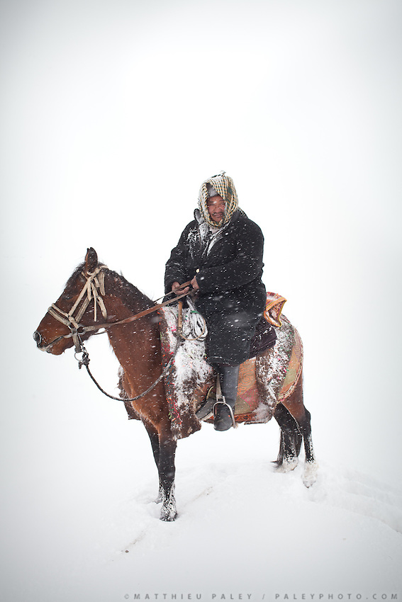 Ustad Ghulam, a Kyrgyz head of camp, on his way between 2 camps after a snow storm..From Kyzyl Qorum to Ech Keli...Trekking with yak caravan through the Little Pamir where the Afghan Kyrgyz community live all year, on the borders of China, Tajikistan and Pakistan.