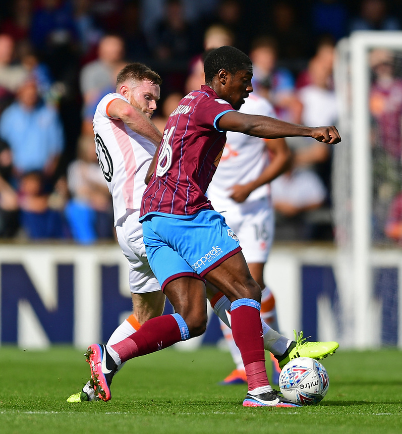 Scunthorpe United's Hakeeb Adelakun under pressure from Blackpool's Oliver Turton<br /> <br /> Photographer Chris Vaughan/CameraSport<br /> <br /> The EFL Sky Bet League One - Scunthorpe United v Blackpool - Saturday 9th September 2017 - Glanford Park - Scunthorpe<br /> <br /> World Copyright &copy; 2017 CameraSport. All rights reserved. 43 Linden Ave. Countesthorpe. Leicester. England. LE8 5PG - Tel: +44 (0) 116 277 4147 - admin@camerasport.com - www.camerasport.com