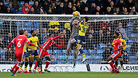Oxford United goalkeeper, Simon Eastwood, catches the ball under pressure from his own teammate, John Mousinho during Oxford United vs MK Dons, Sky Bet EFL League 1 Football at the Kassam Stadium on 1st January 2018