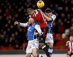 Leon Clarke of Sheffield United tussles with James O'Connor and Matt Preston of Walsall in the air during the English Football League One match at Bramall Lane, Sheffield. Picture date: November 29th, 2016. Pic Jamie Tyerman/Sportimage