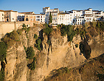 Historic buildings perched on sheer cliff top in Ronda, Spain