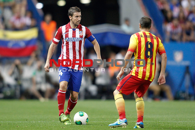 Atletico de Madrid's Gabi Fernandez (l) and FC Barcelona's Andres Iniesta during Supercup of Spain 1st match.August 21,2013. Foto © nph / Acero)