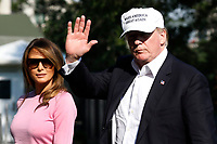 U.S. President Donald Trump waves as walks with First Lady Melania Trump on the South Lawn of the White House upon their return to Washington on July 1, 2018 from Bedminster, NJ. <br /> CAP/MPI/RS<br /> &copy;RS/MPI/Capital Pictures