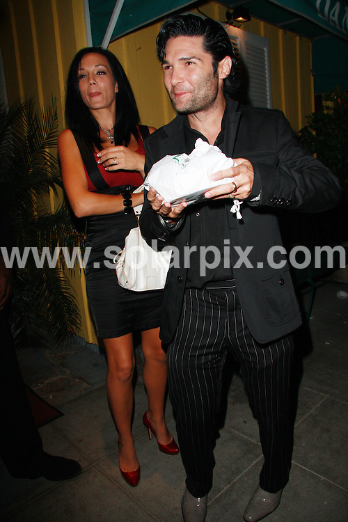 **ALL ROUND PICTURES FROM SOLARPIX.COM**.**WORLDWIDE SYNDICATION RIGHTS**.**NO PUBLICATION IN AUSTRALIA, DENMARK, GERMANY, NEW ZEALAND, OR USA**.Corey Feldman and wife Susie seen enjoying conversation with the surrounding paparazzi after a late dinner at Dan Tana's Restaurant in West Hollywood, California, USA. 4th September 2008..This pic: Susie and Corey Feldman..JOB REF: 7221 LAP(JS)       DATE: 04_09_2008.**MUST CREDIT SOLARPIX.COM OR DOUBLE FEE WILL BE CHARGED* *UNDER NO CIRCUMSTANCES IS THIS IMAGE TO BE REPRODUCED FOR ANY ONLINE EDITION WITHOUT PRIOR PERMISSION*