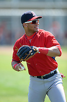 Boston Red Sox second baseman Yoan Moncada (22) warms up in between innings during a minor league spring training game against the Baltimore Orioles on March 18, 2015 at Buck O'Neil Complex in Sarasota, Florida.  (Mike Janes/Four Seam Images)