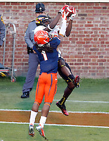 Maryland Terrapins wide receiver Kevin Dorsey (12) makes a catch next to Virginia Cavaliers cornerback Demetrious Nicholson (1) during the game in Charlottesville, Va. Maryland defeated Virginia 27-20.