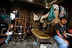 Poverty plagues the indigenous in Guatemala with a low level of living condition. Many live in one-room homes made with cane, mad, and tin sheeting with mad floor and lack of access to clean water, sanitation facilities, stoves and furniture.